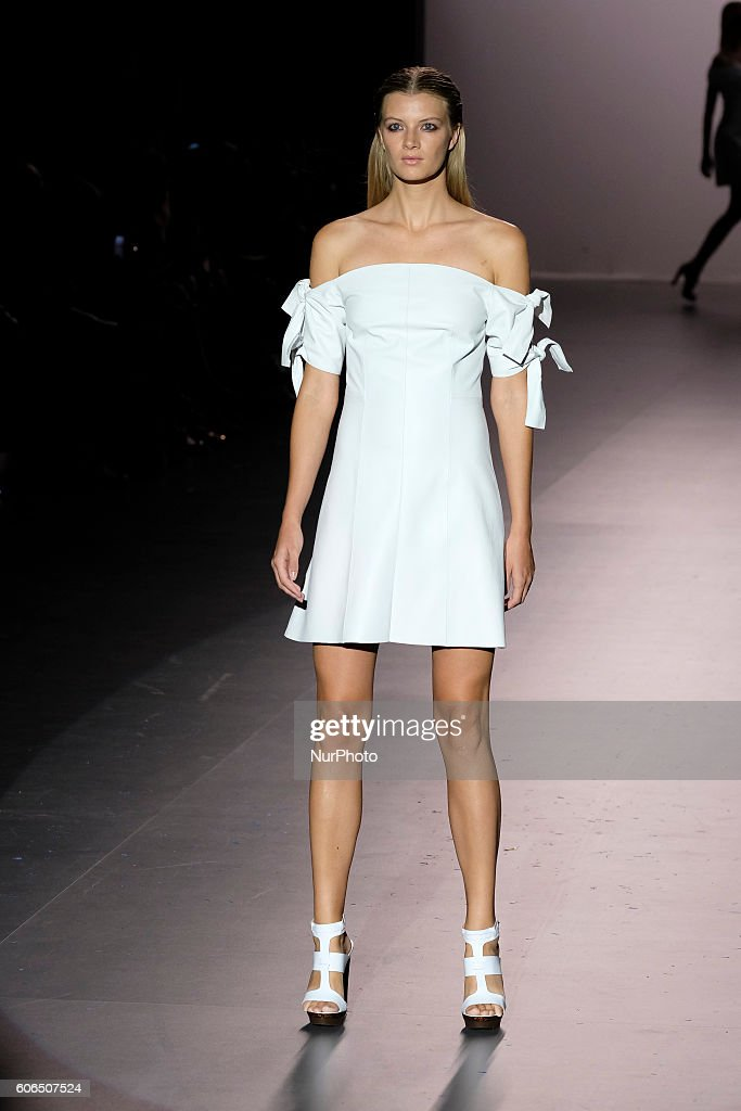 model-showcases-designs-by-roberto-torretta-on-the-runway-at-the-picture-id606507524