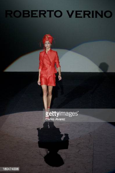 A model showcases designs by Roberto Verino on the runway at Roberto Verino show during Mercedes Benz Fashion Week Madrid Spring/Summer 2014 at Ifema...