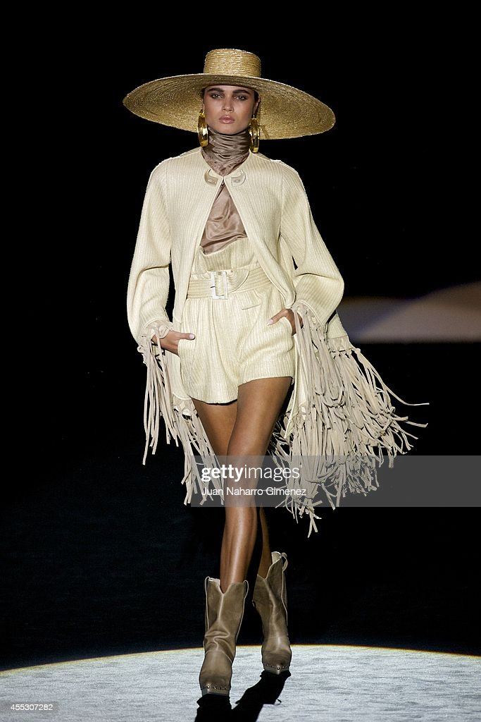 A model showcases designs by Roberto Verino on the runway at the Roberto Verino show during Mercedes Benz Fashion Week Madrid Spring/Summer 2015 at...