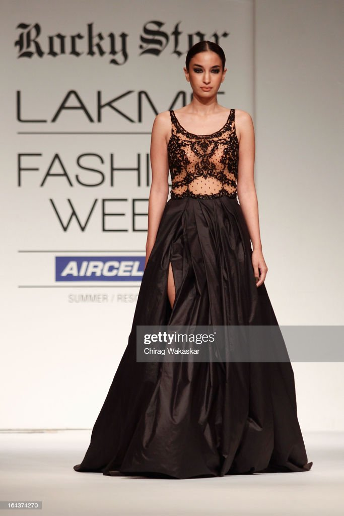 A model showcases designs by Rocky S on the runway during day two of the Lakme Fashion Week Summer/Resort 2013 on March 23, 2013 at Grand Hyatt in Mumbai, India.