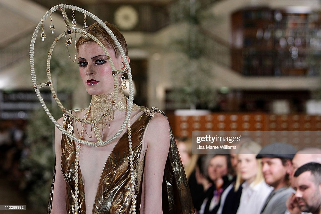 A model showcases designs by Romance Was Born on the catwalk during their Spring/Summer 2011/12 collection launch at the State Library Of New South Wales on May 1, 2011 in Sydney, Australia.