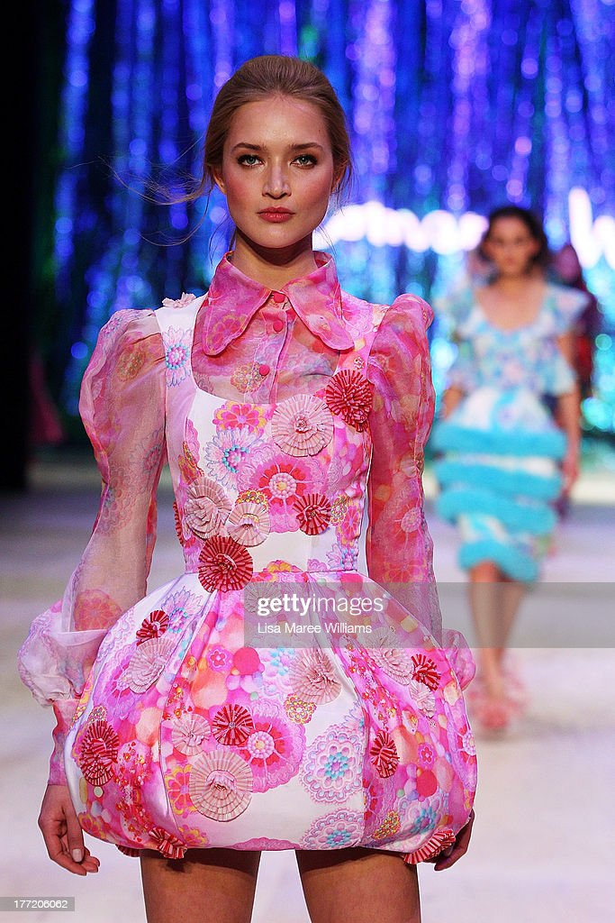 A model showcases designs by Romance Was Born on the runway at the InStyle Red Carpet Runway show during Mercedes-Benz Fashion Festival Sydney 2013 at Sydney Town Hall on August 22, 2013 in Sydney, Australia.