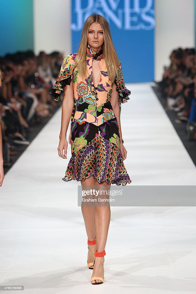 A model showcases designs by Romance Was Born on the runway during the 2014 Virgin Australia Melbourne Fashion Festival Opening Event presented by David Jones at Docklands on March 17, 2014 in Melbourne, Australia.