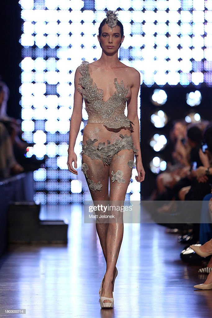A model showcases designs by Ruth Tarvydas on the runway during Perth Fashion Festival at The Western Australian Museum on September 11, 2013 in Perth, Australia.