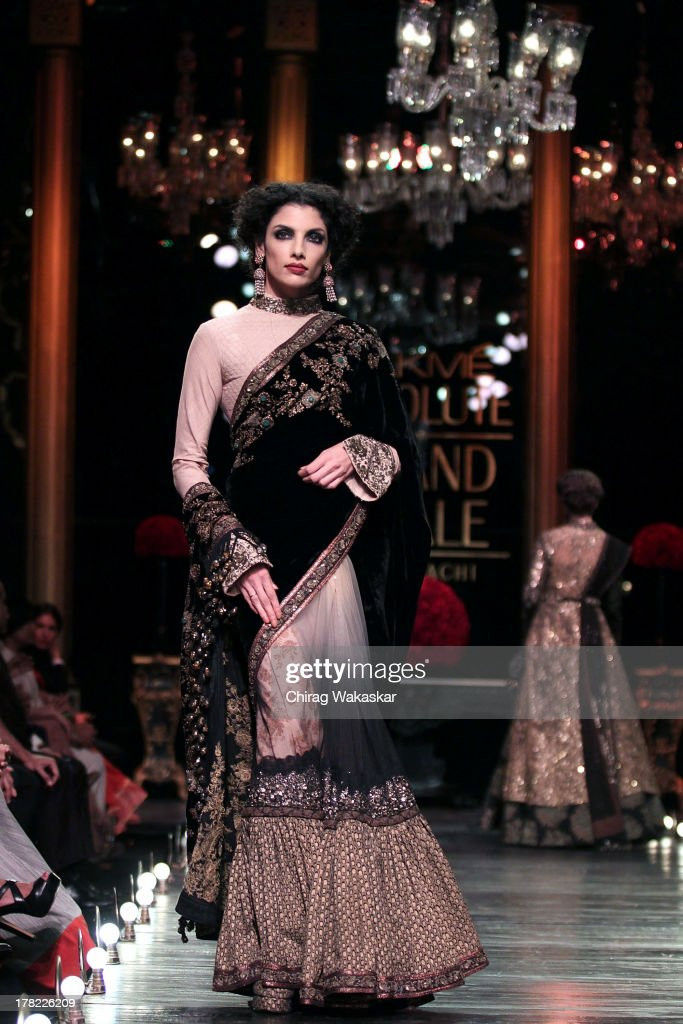 A model showcases designs by Sabyasachi Mukherjee during Grand Finale on day 5 of Lakme Fashion Week Winter/Festive 2013 at the Hotel Grand Hyatt on August 27, 2013 in Mumbai, India.