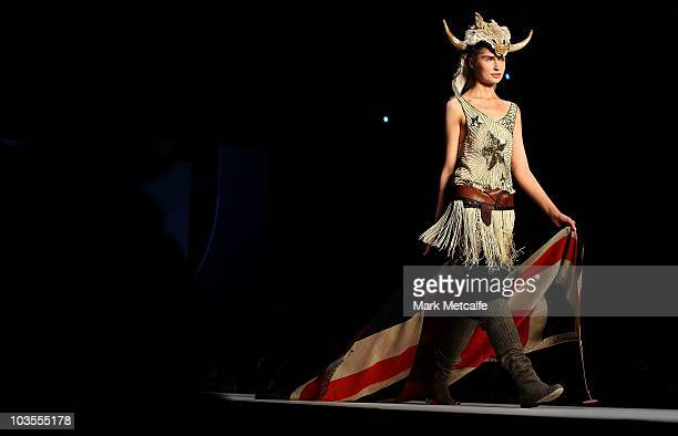 A model showcases designs by Sass Bide on the catwalk during the 'Marie Claire Presents The Gala Opening' catwalk show opening Rosemount Sydney...