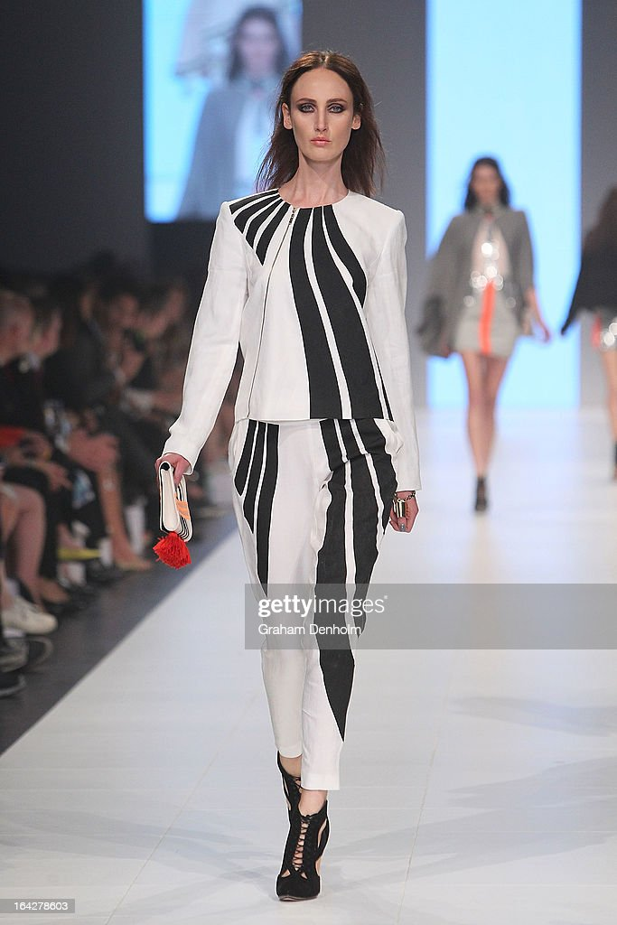 A model showcases designs by Sass & Bide on the runway at the L'Oreal Paris Runway 5 show during day five of L'Oreal Melbourne Fashion Festival on March 22, 2013 in Melbourne, Australia.