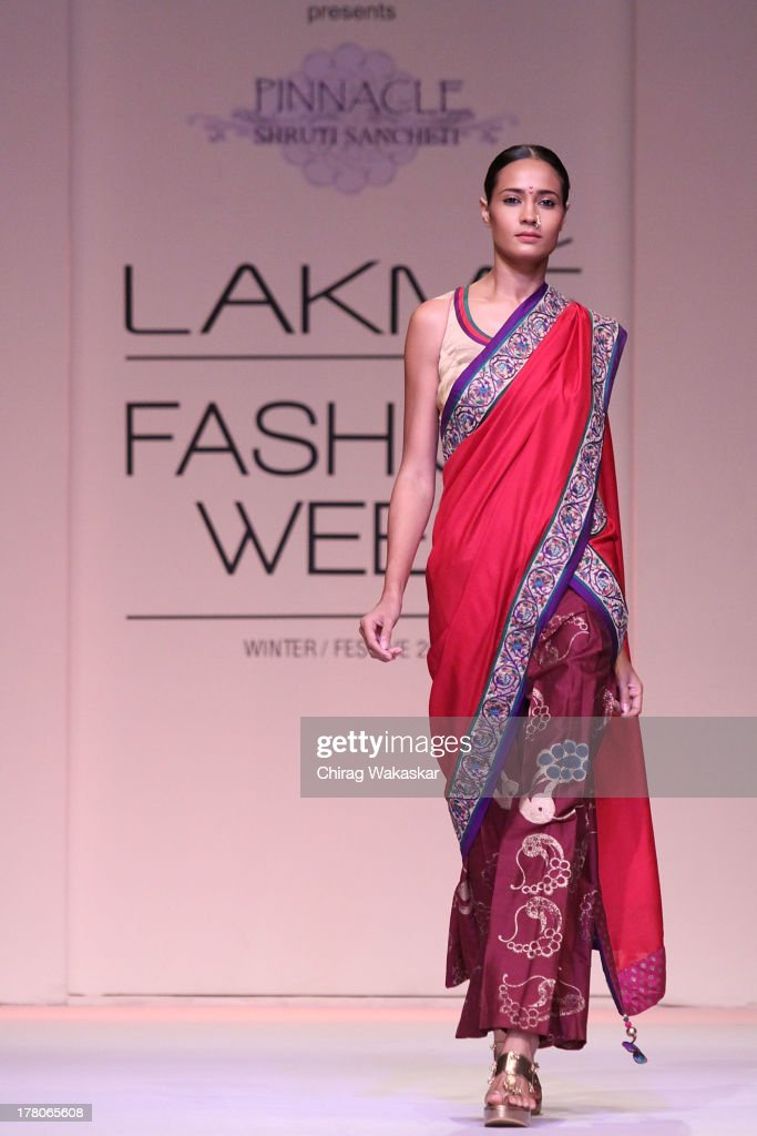 A model showcases designs by Shruti Sancheti\ during day 4 of Lakme Fashion Week Winter/Festive 2013 at the Hotel Grand Hyatt on August 26, 2013 in Mumbai, India.