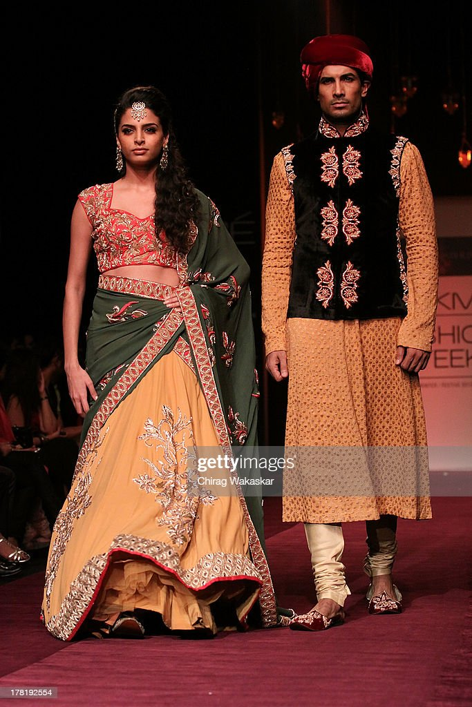 A model showcases designs by Shyamal & Bhumika during day 5 of Lakme Fashion Week Winter/Festive 2013 at the Hotel Grand Hyatt on August 27, 2013 in Mumbai, India.