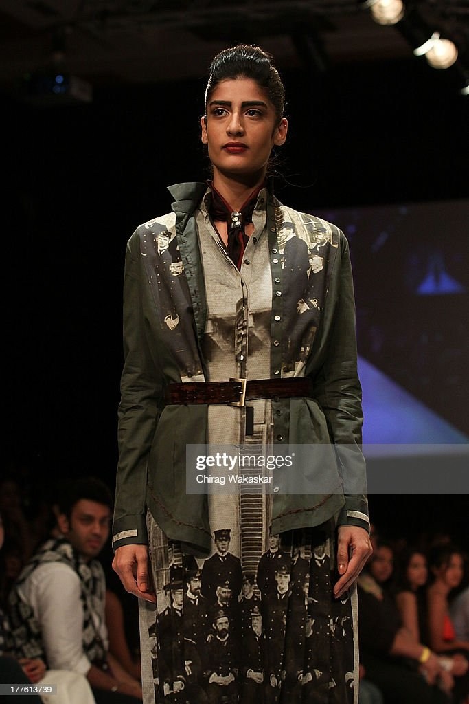 A model showcases designs by Sneha Arora on the runway during day 2 of Lakme Fashion Week Winter/Festive 2013 at the Hotel Grand Hyatt on August 24, 2013 in Mumbai, India.