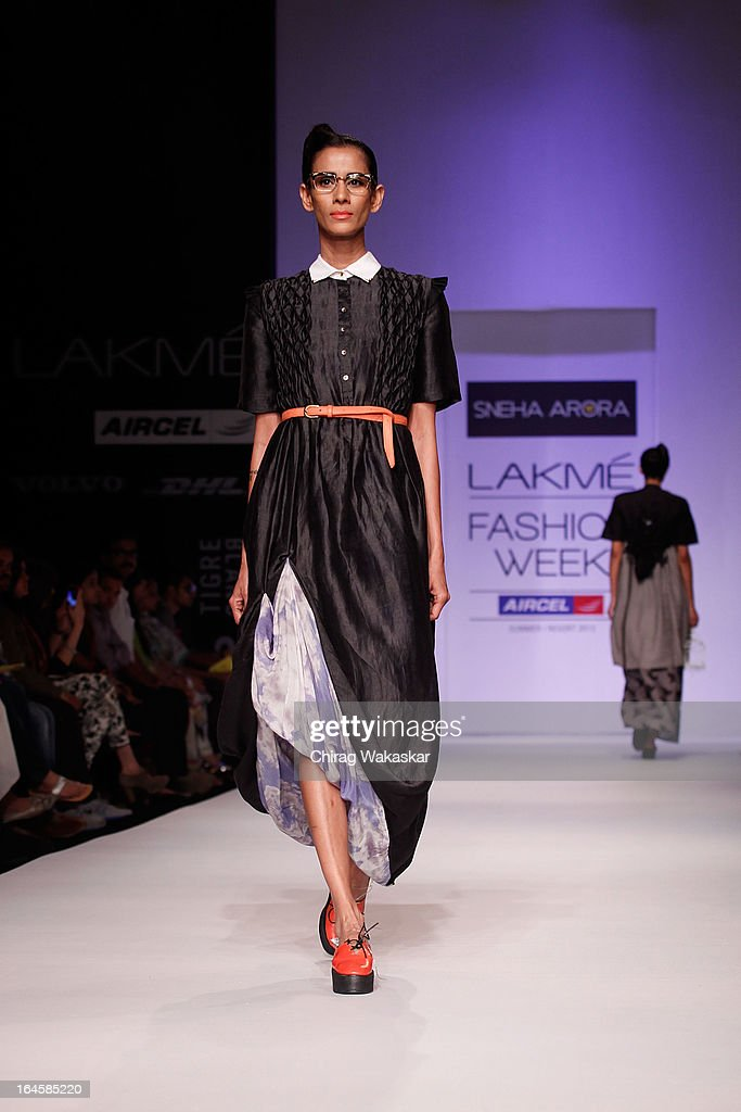 A model showcases designs by Sneha Arora on the runway during day three of Lakme Fashion Week Summer/Resort 2013 on March 24, 2013 at Grand Hyatt in Mumbai, India.