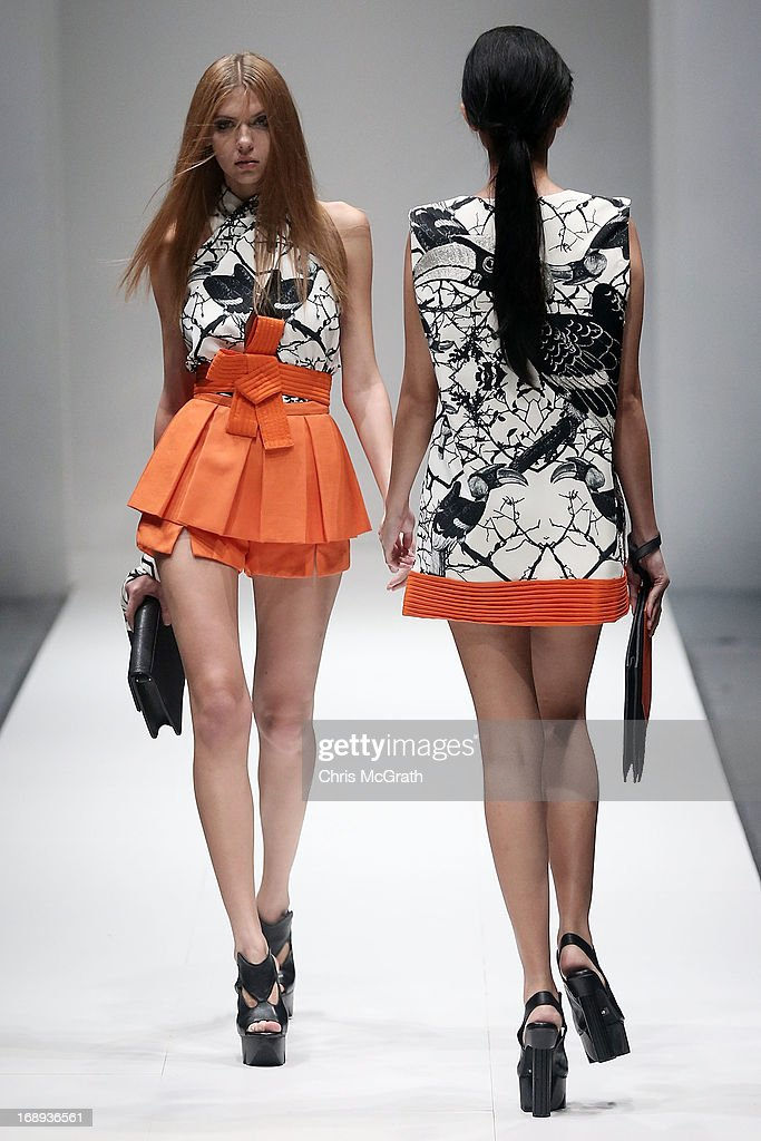 A model showcases designs by Soravit Kaewkamon during the Audi Star Creation Capsule Showcase on May 17, 2013 in Singapore.