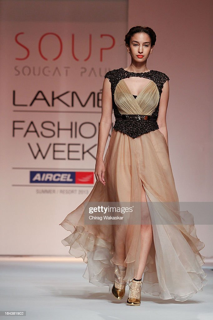 A model showcases designs by Sougat Paul on the runway during day two of the Lakme Fashion Week Summer/Resort 2013 on March 23, 2013 at Grand Hyatt in Mumbai, India.