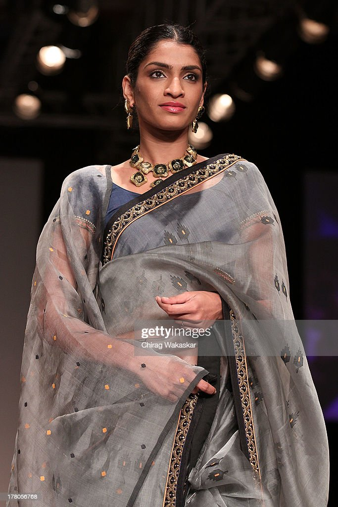 A model showcases designs by Soumitra Mondal during day 4 of Lakme Fashion Week Winter/Festive 2013 at the Hotel Grand Hyatt on August 26, 2013 in Mumbai, India.