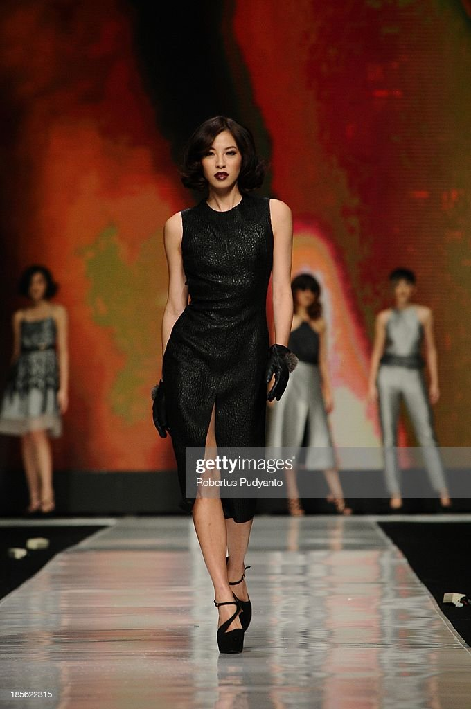 A model showcases designs by Stella Rissa and hair by Andi Lie on the runway at the It Looks Fall Winter 13/14 show during Jakarta Fashion Week 2014 at Senayan City on October 23, 2013 in Jakarta, Indonesia.