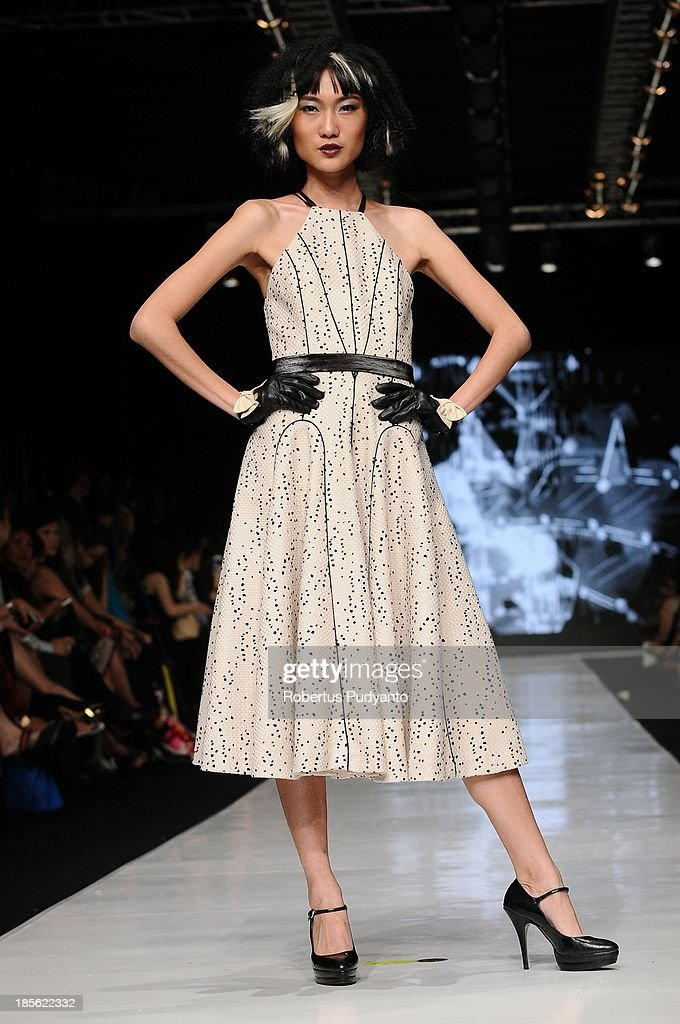 A model showcases designs by Stella Rissa and hair by Arie Hidayat and Bambang Harryono on the runway at the It Looks Fall Winter 13/14 show during Jakarta Fashion Week 2014 at Senayan City on October 23, 2013 in Jakarta, Indonesia.