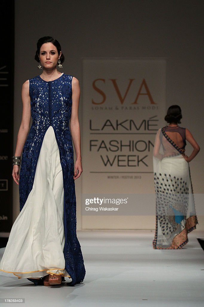 A model showcases designs by SVA during day 5 of Lakme Fashion Week Winter/Festive 2013 at the Hotel Grand Hyatt on August 27, 2013 in Mumbai, India.