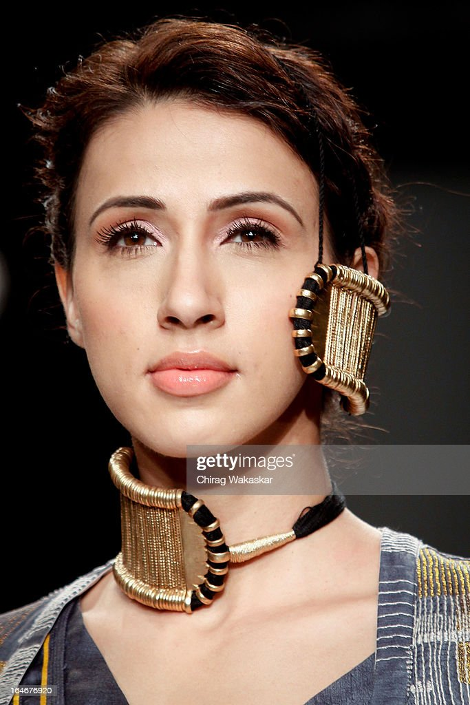 A model showcases designs by Swati Kalsi on the runway during day four of Lakme Fashion Week Summer/Resort 2013 on March 25, 2013 at Grand Hyatt in Mumbai, India.