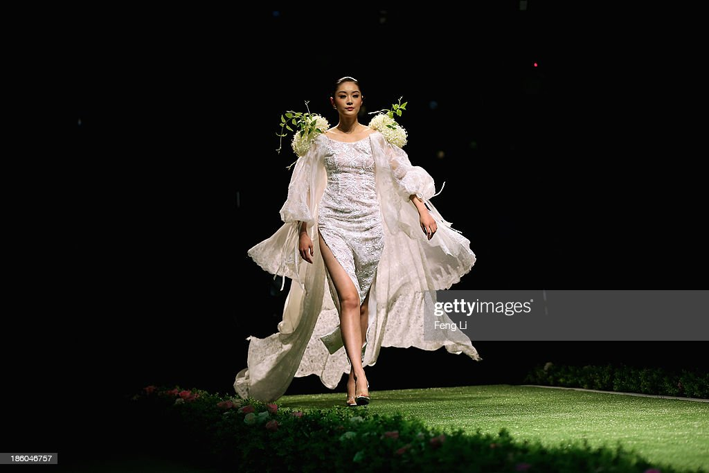 A model showcases designs by Taiwanese designer Tsai Meiyue on the runway at Tsai Meiyue Wedding Dress Collection show during Mercedes-Benz China Fashion Week Spring/Summer 2014 at Beijing Hotel on October 27, 2013 in Beijing, China.