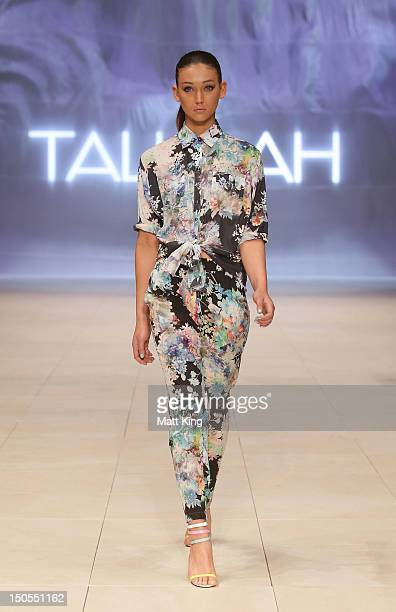 A model showcases designs by Talulah on the catwalk as part of Mercedes Benz Fashion Festival Sydney 2012 at Sydney Town Hall on August 21 2012 in...