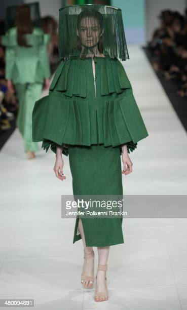 A model showcases designs by Tan Thanh Trieu on the runway during the National Graduate Showcase Presented by Target show at Melbourne Fashion...