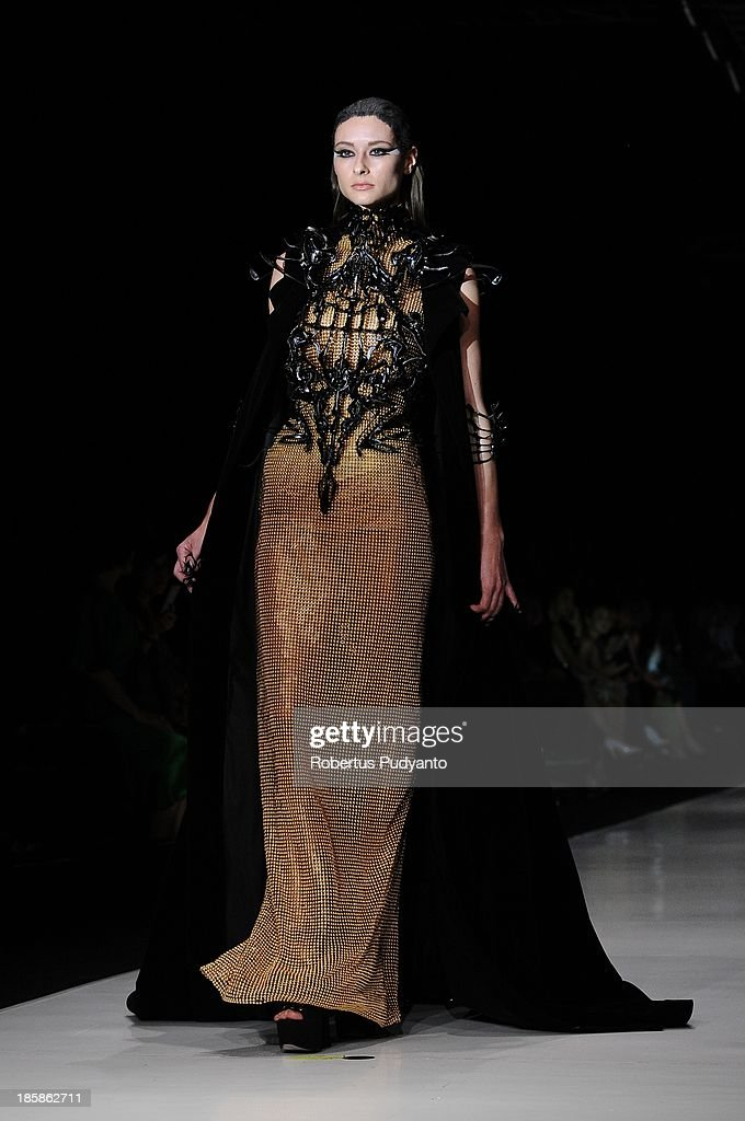 A model showcases designs by Tex Saverio on the runway at the Prive show during Jakarta Fashion Week 2014 at Senayan City on October 25, 2013 in Jakarta, Indonesia.