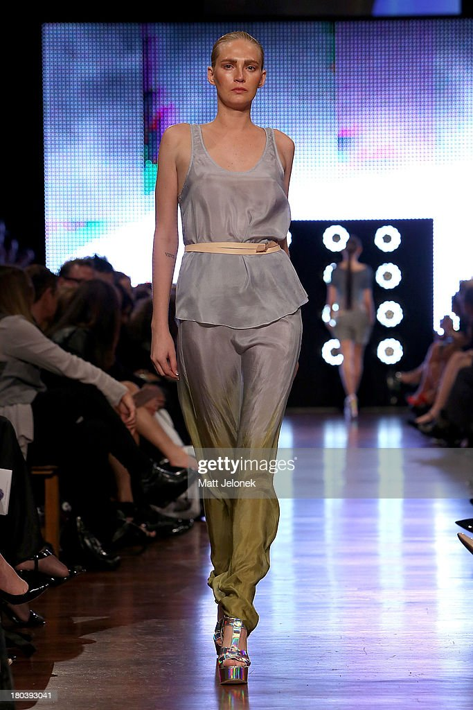 A model showcases designs by The Butcher and The Crow on the runway during Perth Fashion Festival at the Western Australian Museum on September 12, 2013 in Perth, Australia.