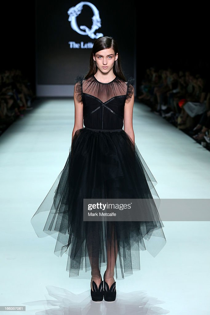 A model showcases designs by The Letter Q on the runway at the New Generation show during Mercedes-Benz Fashion Week Australia Spring/Summer 2013/14 at Carriageworks on April 12, 2013 in Sydney, Australia.