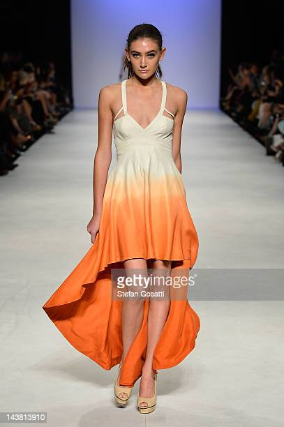 A model showcases designs by Uscari on the catwalk during the New Generation 2 group show on day five of Mercedes Benz Fashion Week Australia...