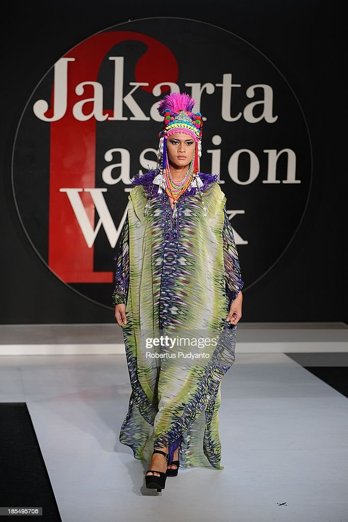 A model showcases designs by Watchara of Thailand on the runway during Jakarta Fashion Week 2014 at Senayan City on October 21, 2013 in Jakarta, Indonesia.