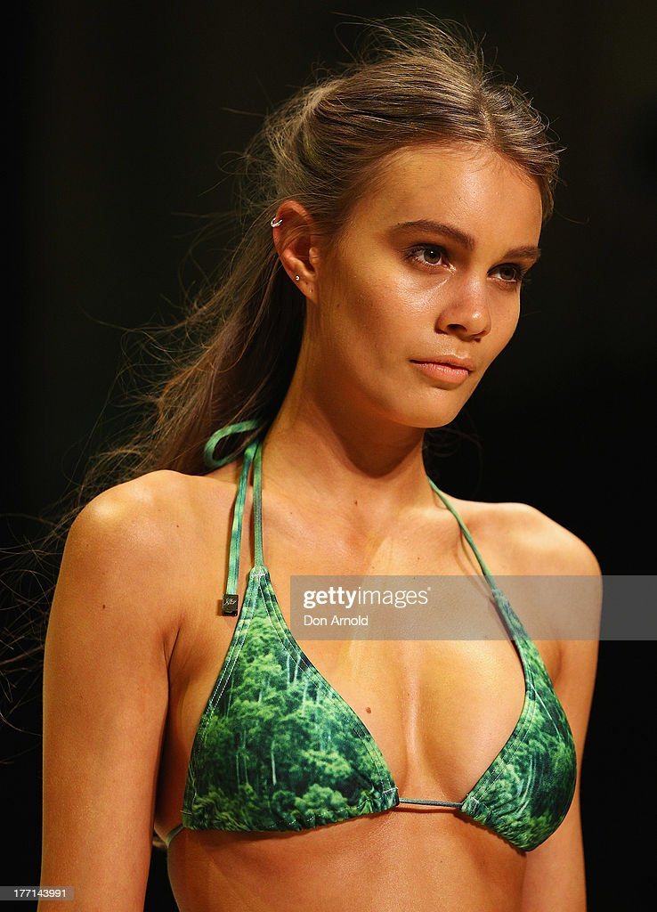 A model showcases designs by White Sands on the runway at the MBFWA Trends show during Mercedes-Benz Fashion Festival Sydney 2013 at Sydney Town Hall on August 21, 2013 in Sydney, Australia.