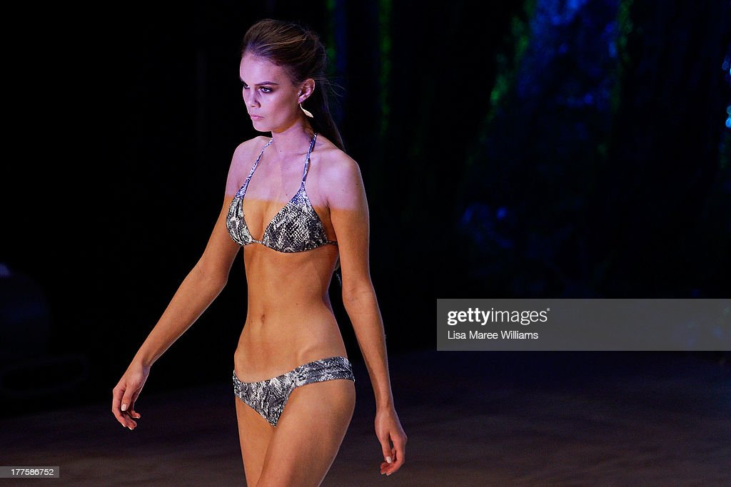 A model showcases designs by White Sands on the runway at the MBFWA Trends show during Mercedes-Benz Fashion Festival Sydney 2013 at Sydney Town Hall on August 24, 2013 in Sydney, Australia.