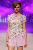 A model showcases designs by Whitney Eve on the catwalk as part of the the MercedesBenz Fashion festival Sydney 2012 at Sydney Town Hall on August 25...