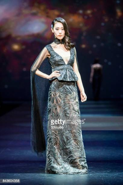 A model showcases designs by Winsome Lok on the runway during the Designers' Collection Show 1 on the Day 2 of the CentreStage Hong Kong 2017 at Hong...