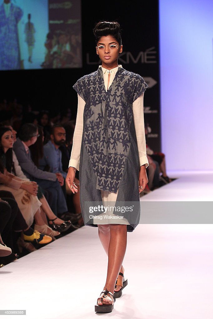 A model showcases designs by XXX during day 3 of Lakme Fashion Week Winter/Festive 2014 at The Palladium Hotel on August 22, 2014 in Mumbai, India.