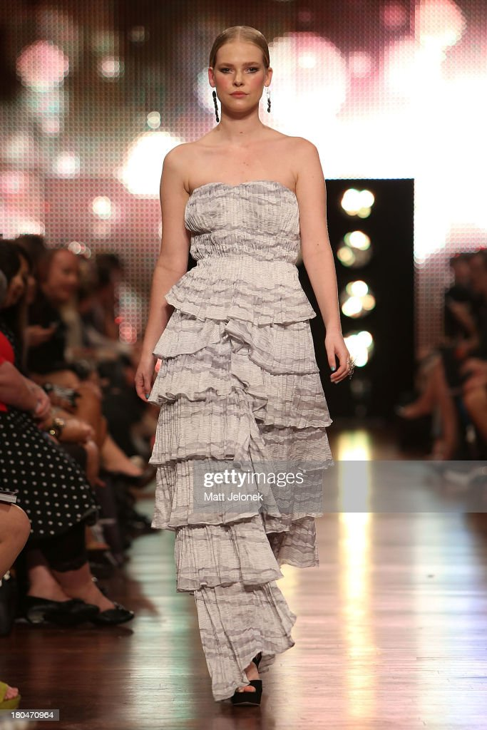 A model showcases designs by Yan Zion on the runway during Perth Fashion Festival at The Western Australian Museum on September 13, 2013 in Perth, Australia.
