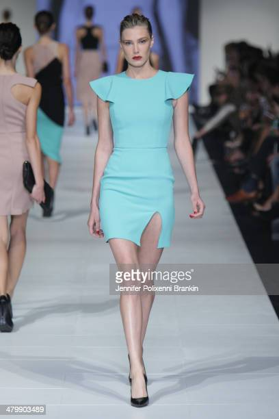 A model showcases designs by Yeojin Bae on the runway during the Premium Runway 6 Presented by Harper's BAZAAR show at Melbourne Fashion Festival on...