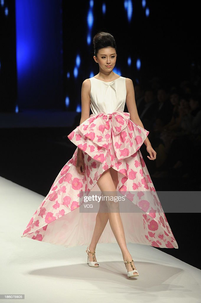 A model showcases designs by Yuan Bing on the runway at the VISCAP Yuan Bing Collection show during Mercedes-Benz China Fashion Week Spring/Summer 2014 at Beijing Hotel on October 28, 2013 in Beijing, China.