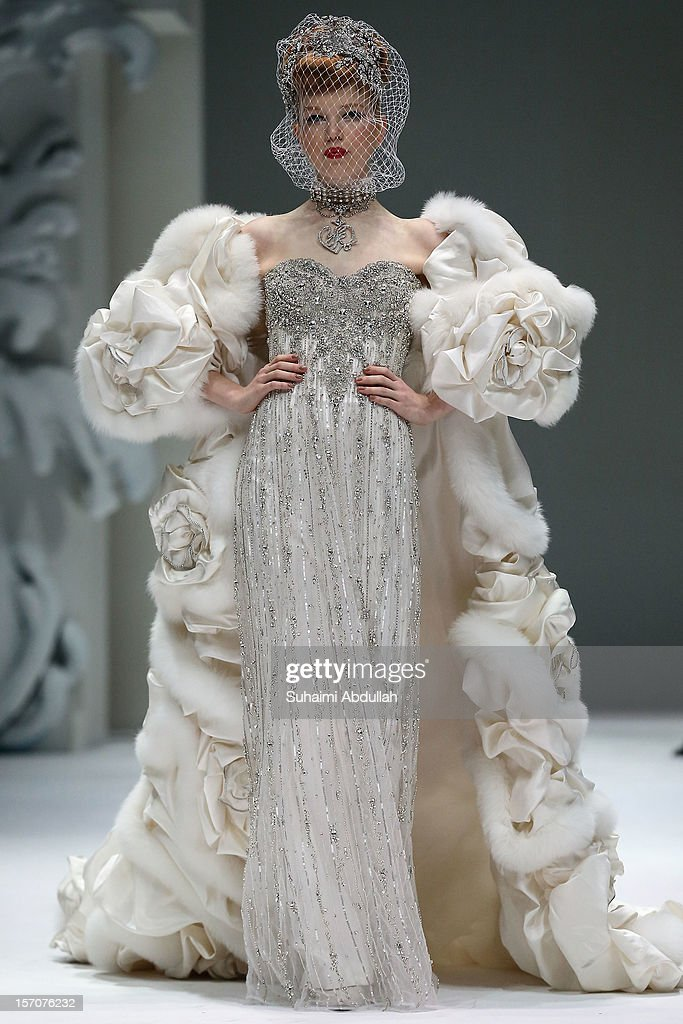 A model showcases designs by Yumi Katsura during Japan Couture 2012 Singapore at The Shoppes at Marina Bay Sands on November 28, 2012 in Singapore.