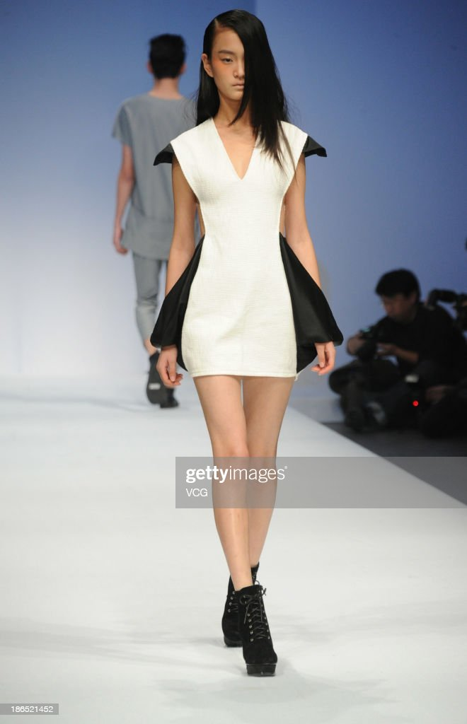 A model showcases designs by Zhang Beiyong on the runway at the JUST FOR TEE Zhang Beiyong Collection show during Mercedes-Benz China Fashion Week Spring/Summer 2014 at 751 D.PARK Central Hall on October 31, 2013 in Beijing, China.
