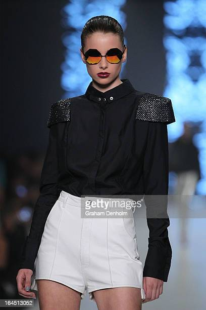 A model showcases designs by Zhivago on the runway at the Independent Runway show during day seven of L'Oreal Melbourne Fashion Festival on March 24...