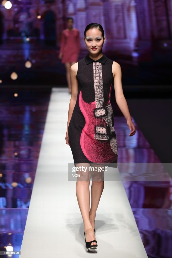 A model showcases designs by Zhuang Ganran on the runway at the Rabbit WarmZhuang Ganran Collection show during Mercedes-Benz China Fashion Week Spring/Summer 2014 at Beijing Hotel on October 27, 2013 in Beijing, China.