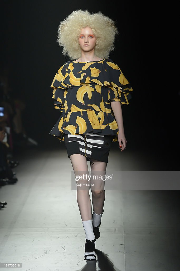 A model showcases designs during the DRESSCAMP runway as part of Mercedes Benz Fashion Week TOKYO 2014 S/S at the Hikarie A hall of Shibuya Hikarie on October 15, 2013 in Tokyo, Japan.
