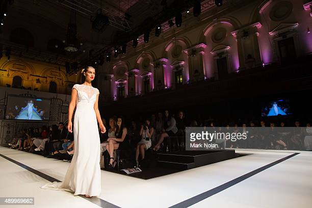 A model showcases designs during the Red Carpet show at MercedesBenz Fashion Festival Sydney 2015 at Sydney Town Hall on September 25 2015 in Sydney...