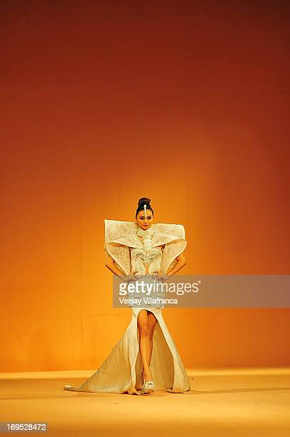A model showcases designs from the Grand Allure collection by various designers on the runway at the last day of the Philippine Fashion Week Holiday...