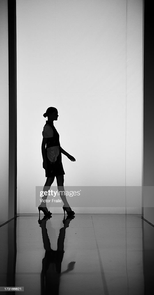 A model showcases designs of Anthony Bachtiar on the runway during the Designer Collection Show on day 2 of Hong Kong Fashion Week Spring/Summer 2013 at the Hong Kong Convention and Exhibition Centre on July 9, 2013 in Hong Kong, China.