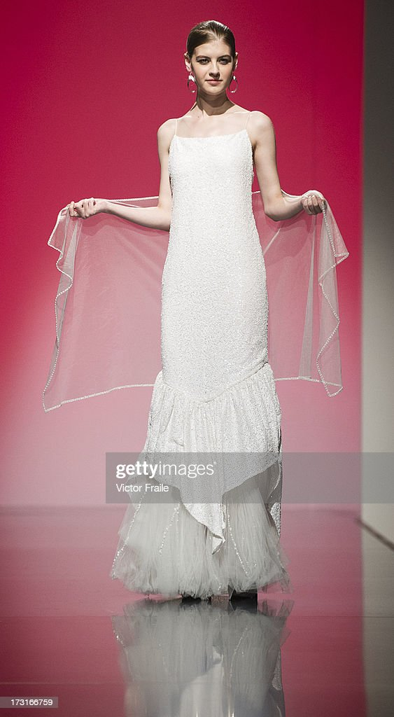 A model showcases designs of Christine Lam on the runway during the Designer Collection Show on day 2 of Hong Kong Fashion Week Spring/Summer 2013 at the Hong Kong Convention and Exhibition Centre on July 9, 2013 in Hong Kong, China.