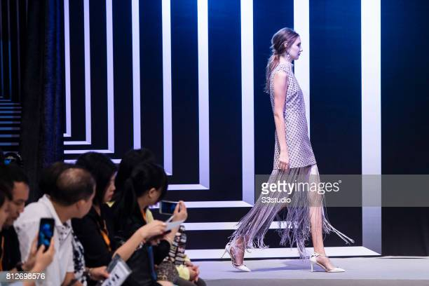 Model showcases designs of Helen Kei and Hiu Hung on the runway on the Day 2 of the Hong Kong Fashion Week for Spring/Summer 2017 at the Hong Kong...