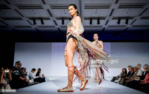 Model showcases designs of Homan Ho Ching Man Cherry Chan Wan Man Rachel Lai Yuen Yan and Grace Tsoi Hiu Ling on the runway during the PolyU Intimate...