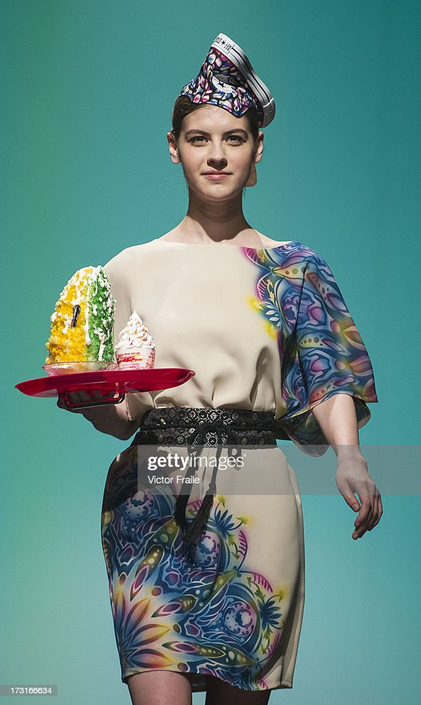 A model showcases designs of Kanna Yamauchi Yokang on the runway during the Designer Collection Show on day 2 of Hong Kong Fashion Week Spring/Summer 2013 at the Hong Kong Convention and Exhibition Centre on July 9, 2013 in Hong Kong, China.
